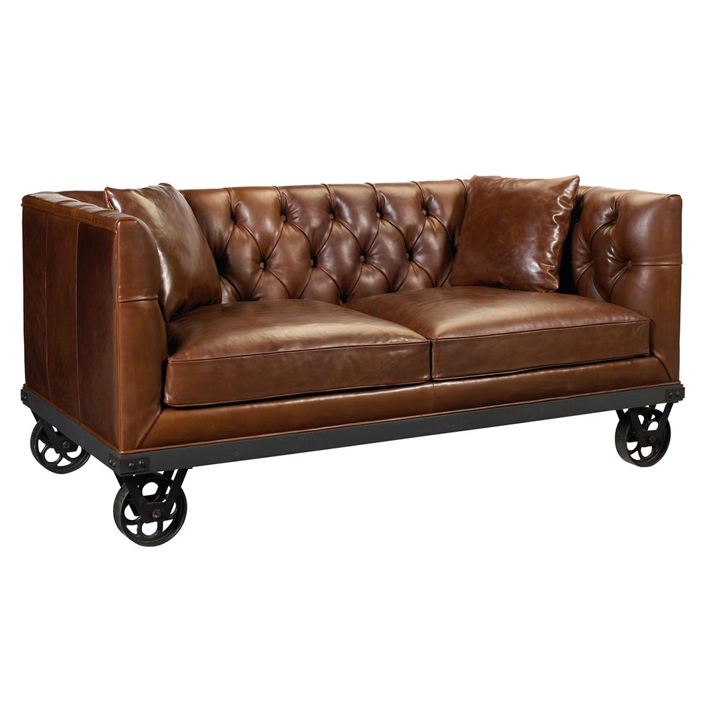 Mouille industrial loft wheels rich brown leather sofa for Industrial couch