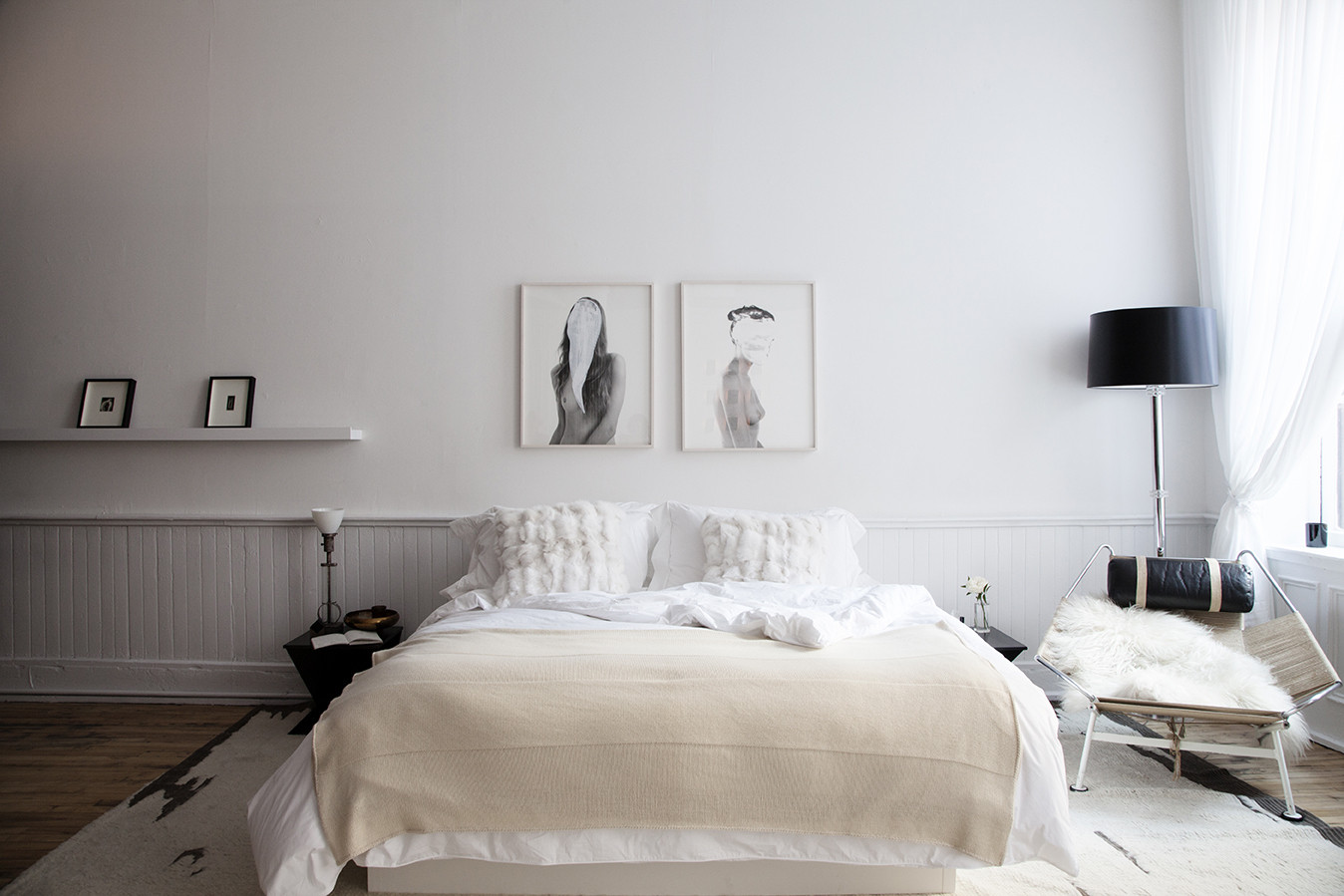 white bedroom interior with fur pillows
