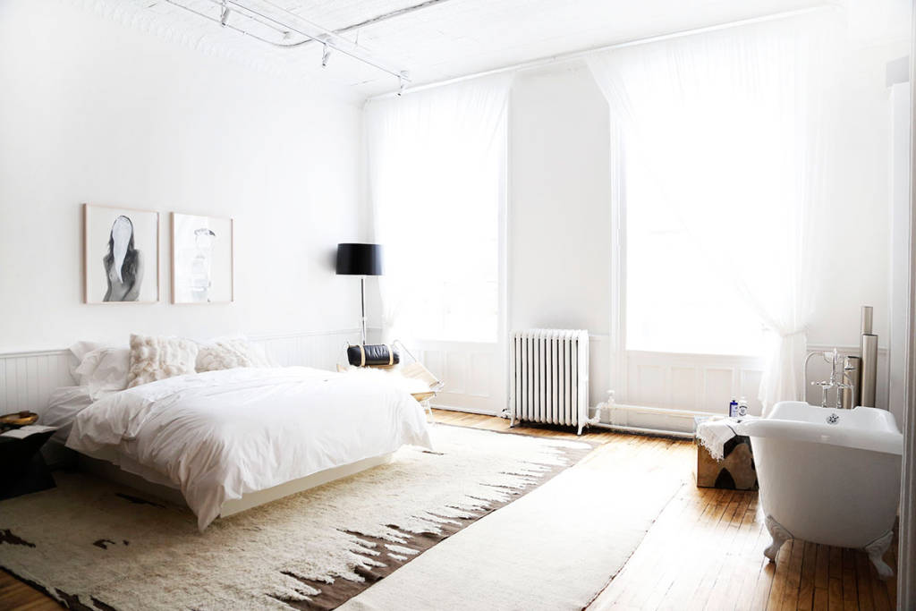 white bedroom with bathtub