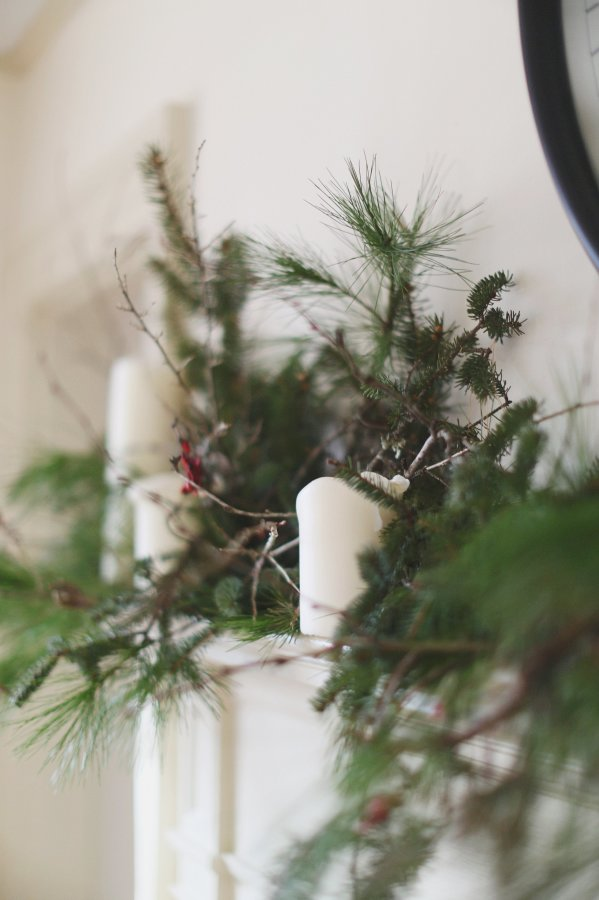 holiday greenery and white candles