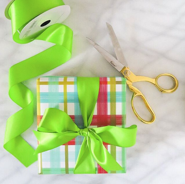 present with plaid wrapping paper and green ribbon