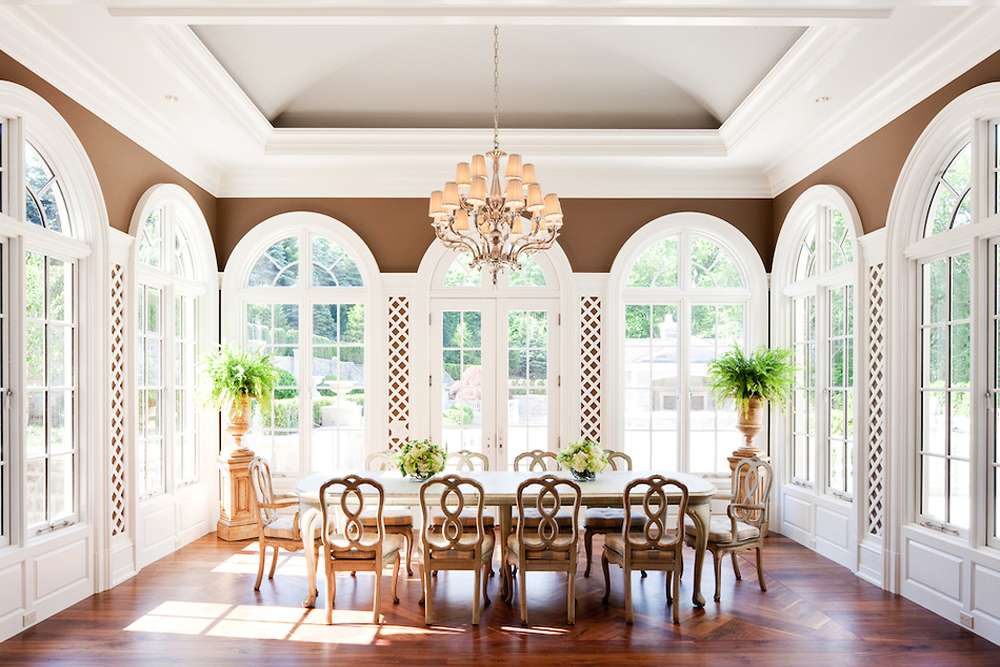 10 Stunning Sunroom Ideas and Tips to Light Up Your Home | Kathy Kuo on dining ceiling design, ballroom ceiling design, sunroom floor, kitchen ceiling design, tile ceiling design, entryway ceiling design, patio ceiling design, balcony ceiling design, sunroom walls, entrance ceiling design, sunroom architecture, office ceiling design, air conditioning ceiling design, library ceiling design, studio ceiling design, stairwell ceiling design, open floor plan ceiling design, bar ceiling design, room ceiling design, shed ceiling design,