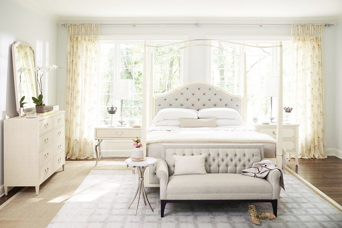 bedroom with white canopy bed