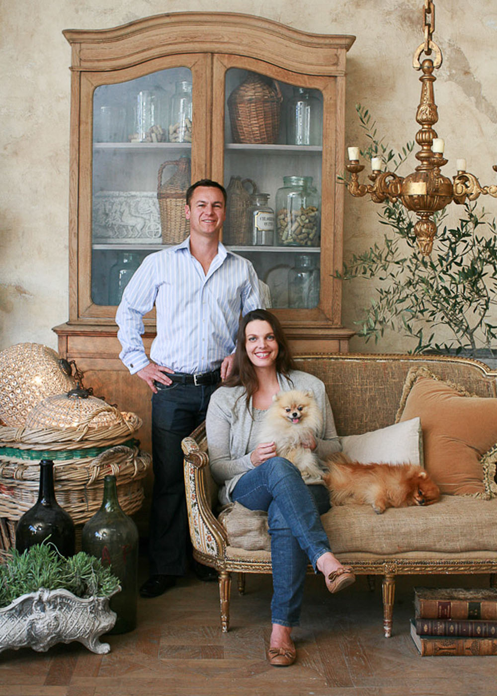 couple with dogs in an eloquence French country living room