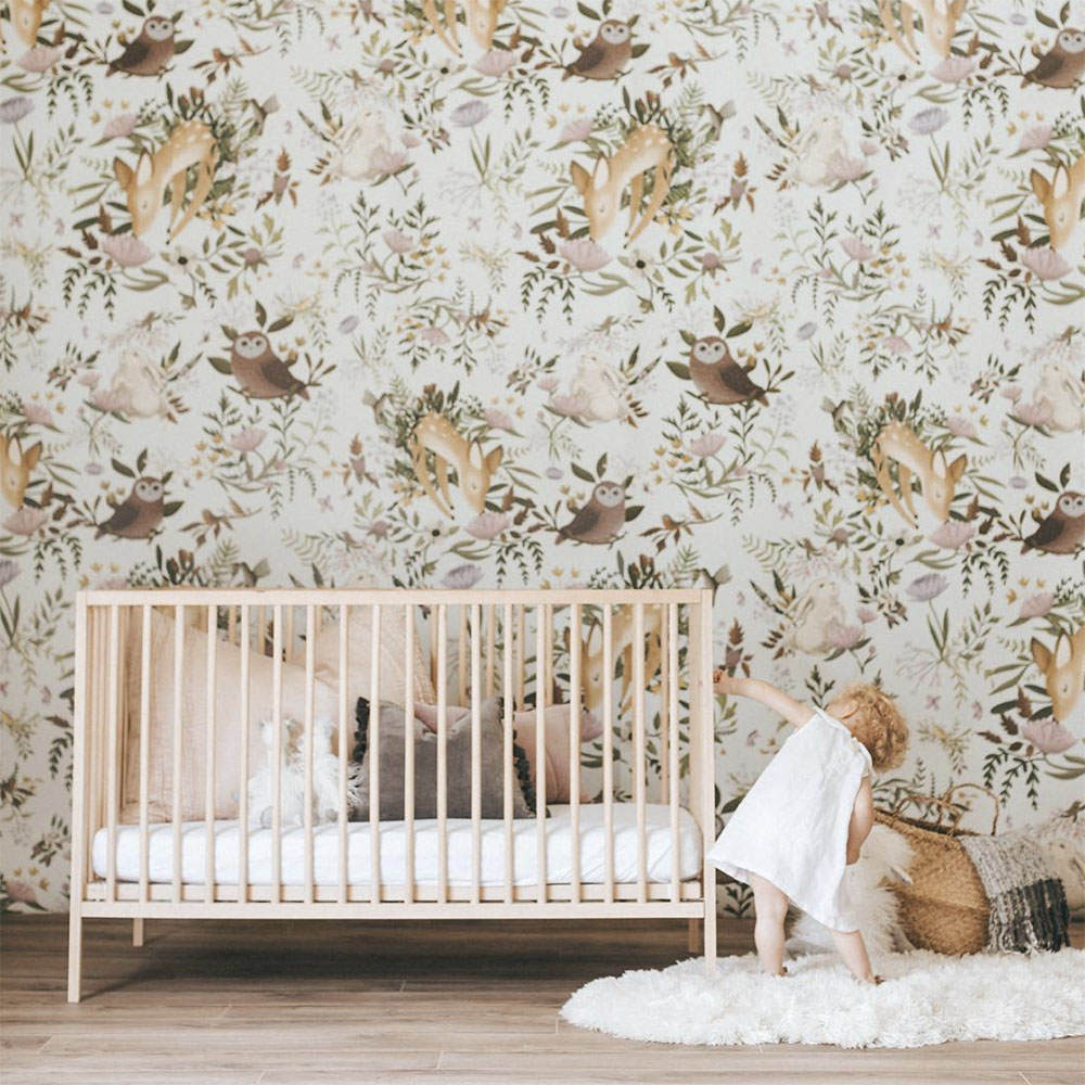 nursery with forest inspired wallpaper