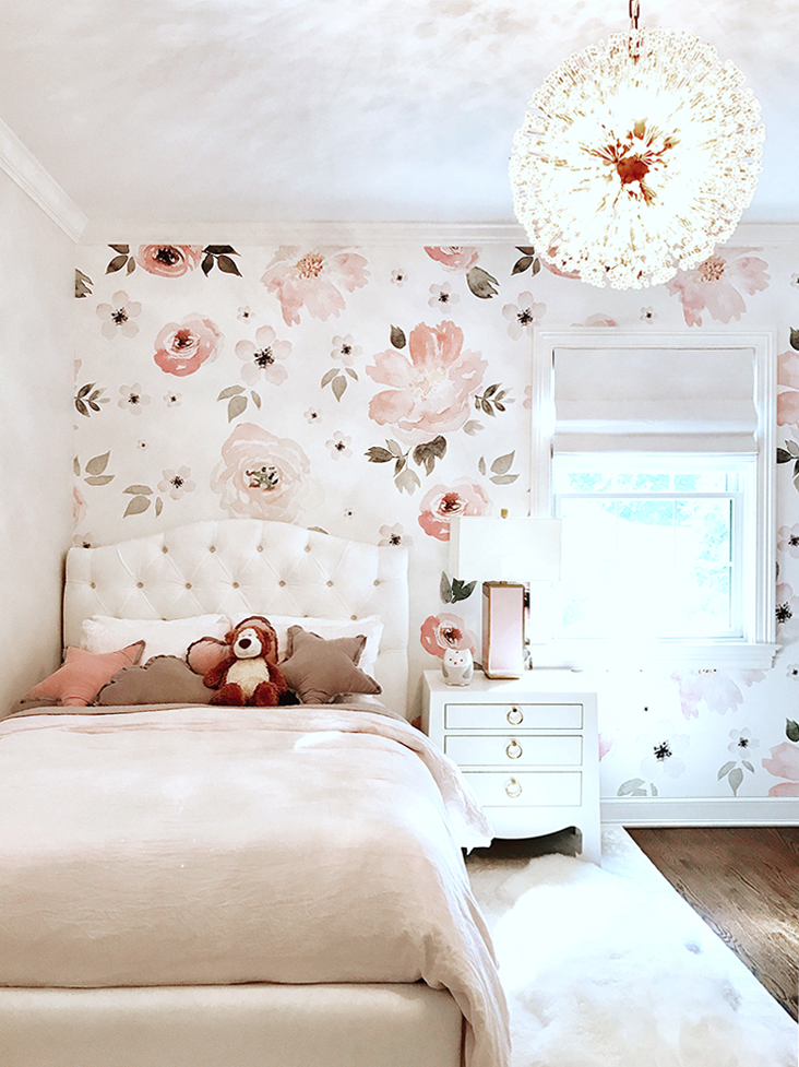 pink kids room with floral wallpaper