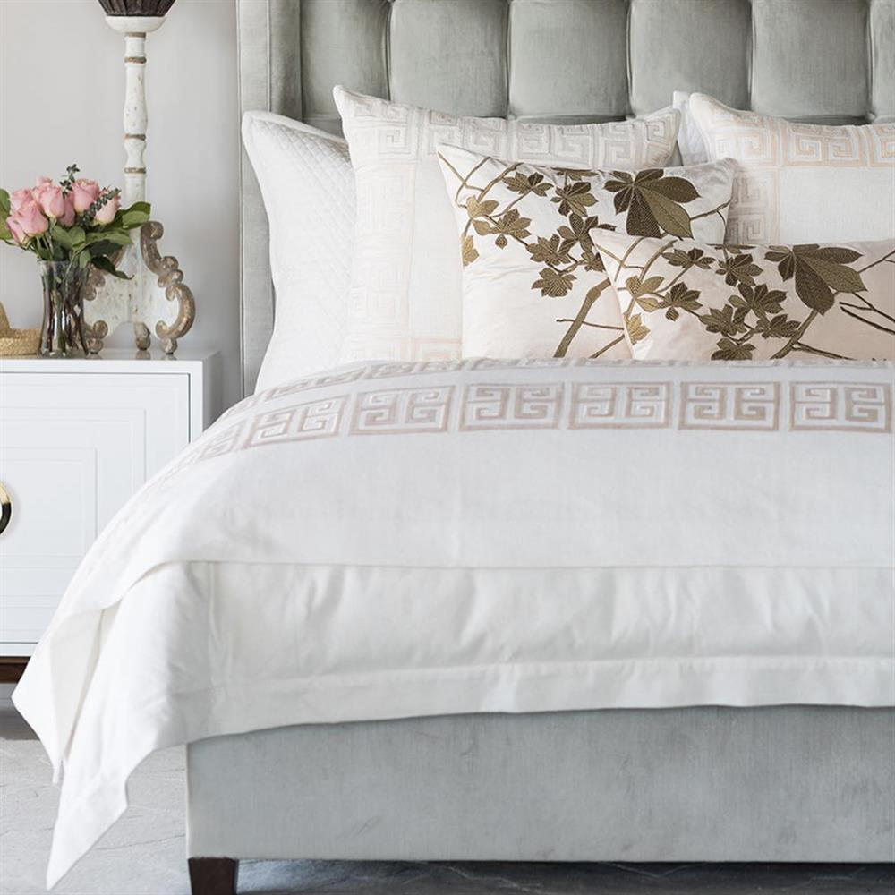 bed with white sheets and decorative pillows