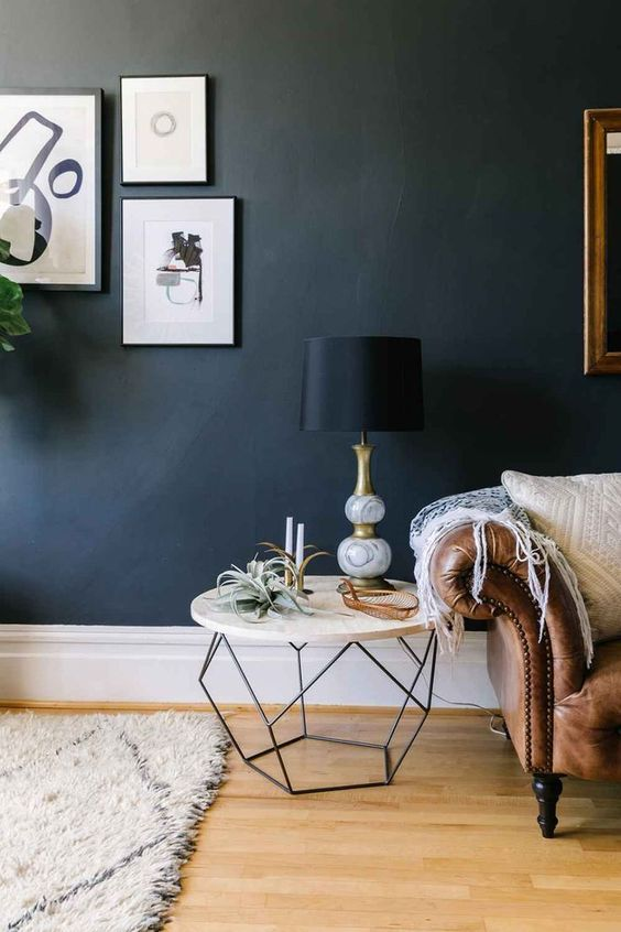living room with navy blue walls