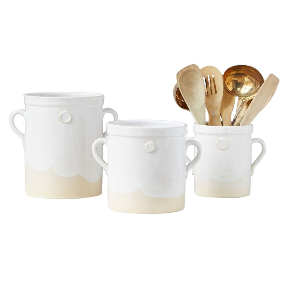 set of three ceramic crocks with utensils