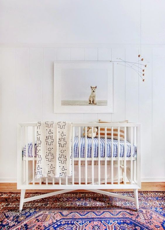 cute crib on patterned rug