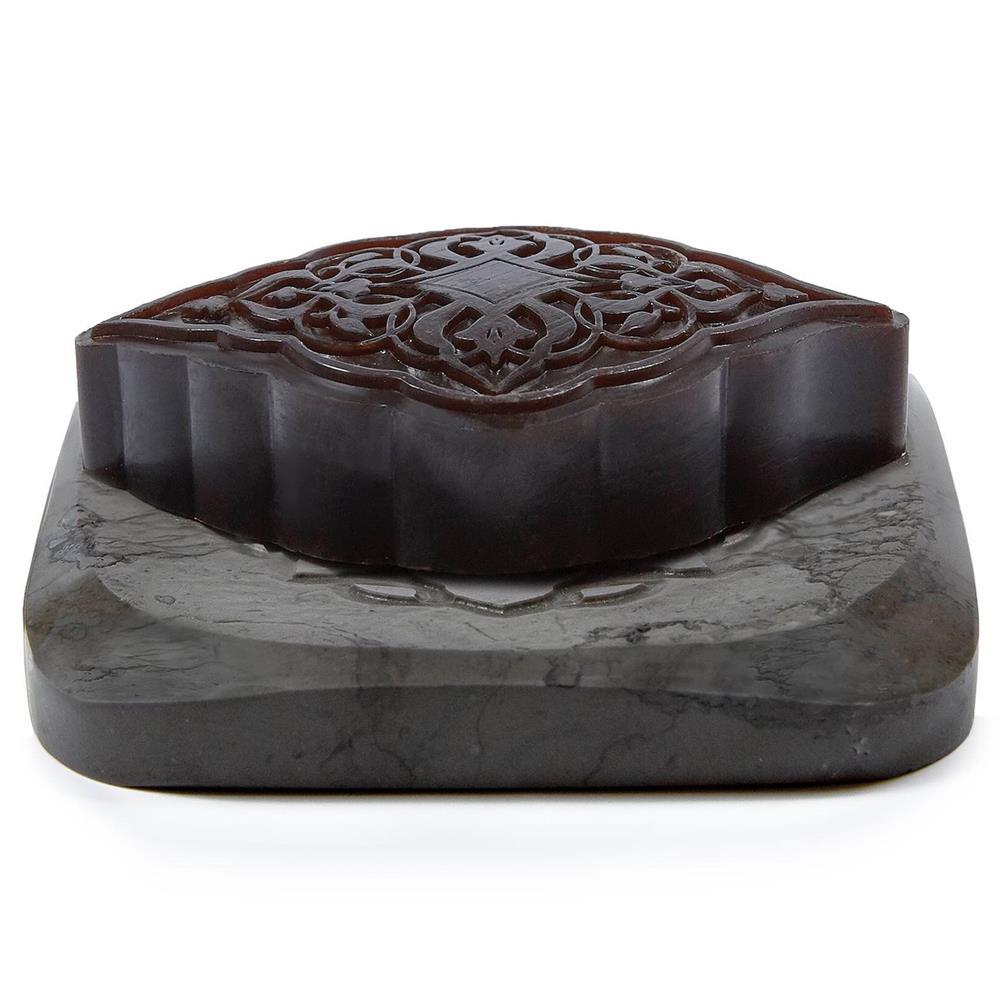 dark colored soap on a gray dish