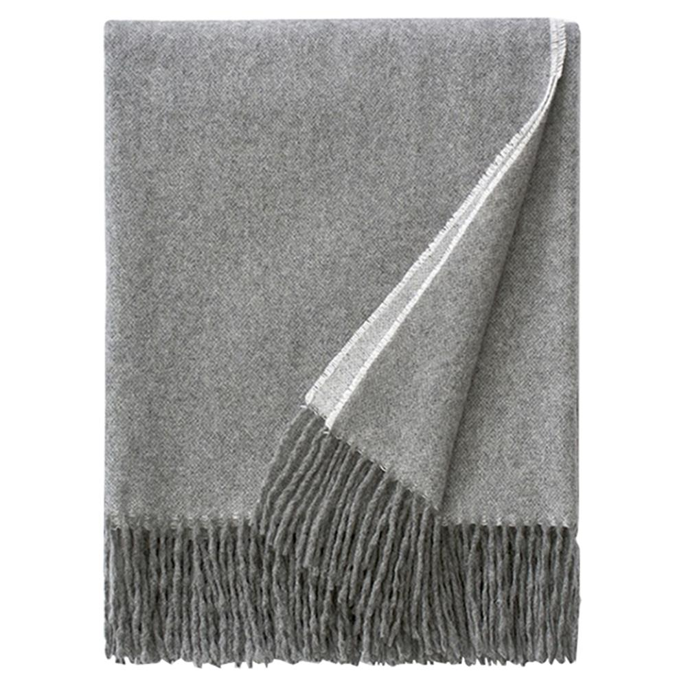 Fringed throw blanket