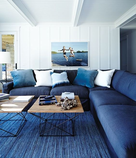 living room with blue rug and couch