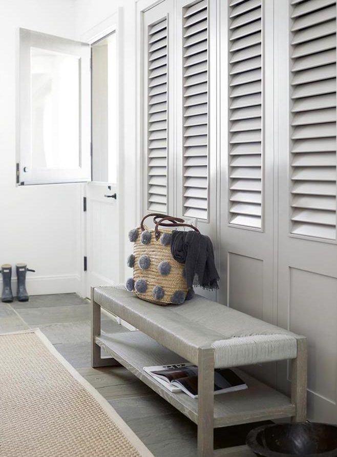 entryway with boho style bench
