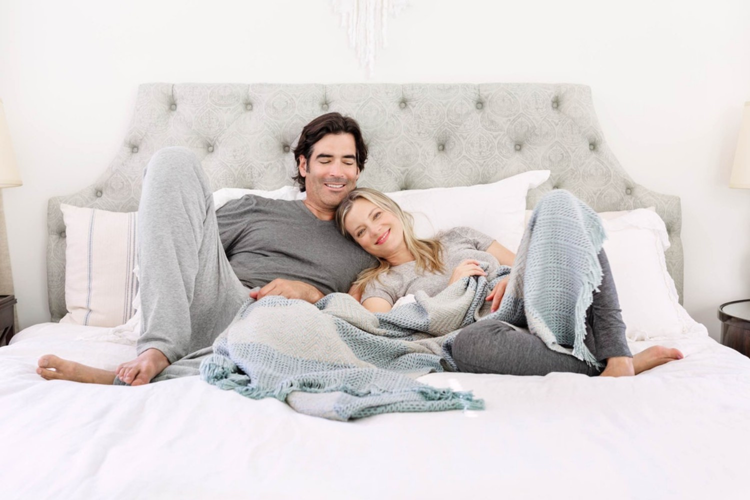 couple on bed lounging